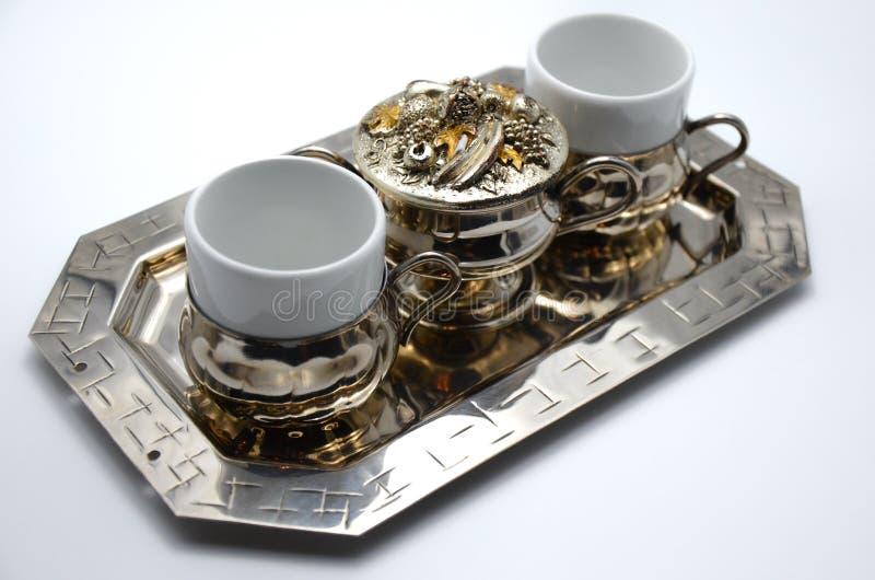 Un ensemble de tasses de café argentées image libre de droits