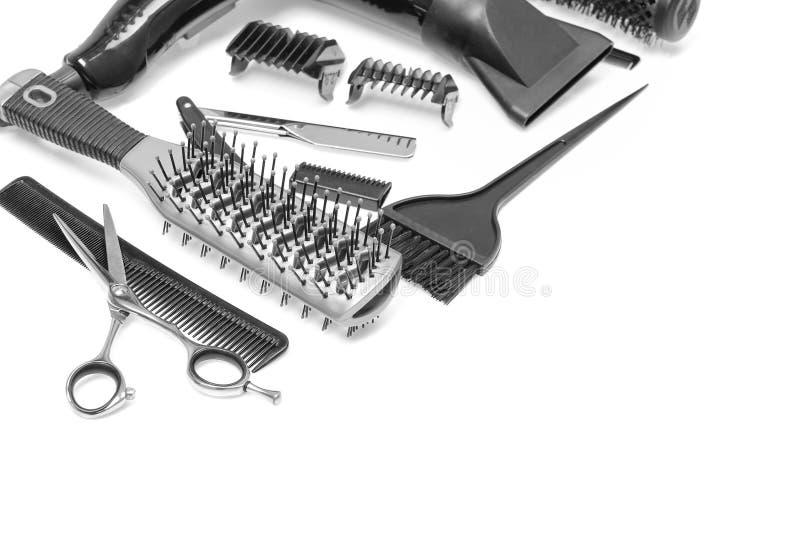 Un ensemble des accessoires du coiffeur d'isolement Image courante images stock
