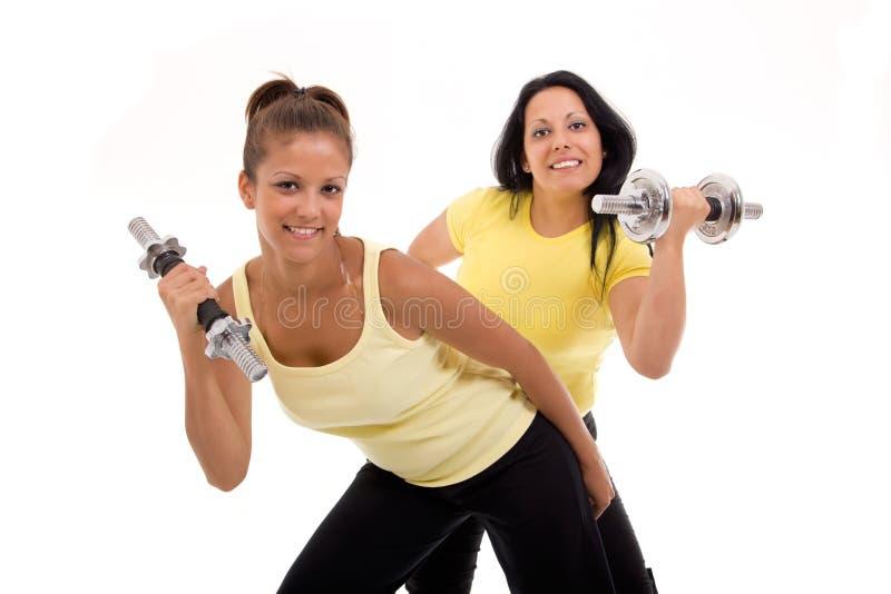 Un'esercitazione sana delle due donne immagini stock libere da diritti