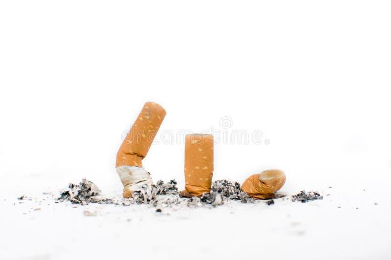 Un'estremità di tre sigarette immagini stock libere da diritti
