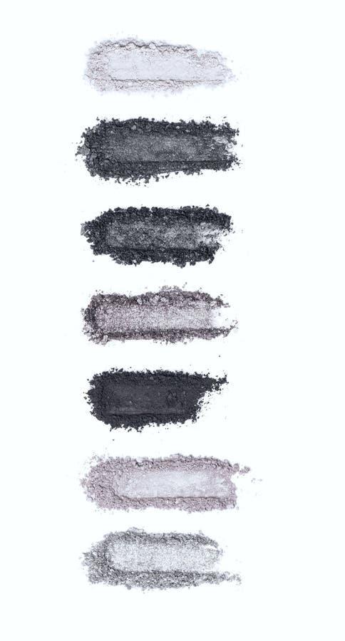 Un fard à paupières modifié la tonalité heurté et gris composent la palette d'isolement sur un fond blanc photos stock