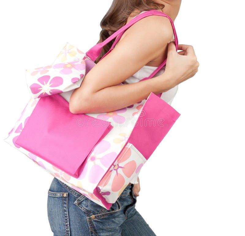 Un femme portant un sac à main rose images stock