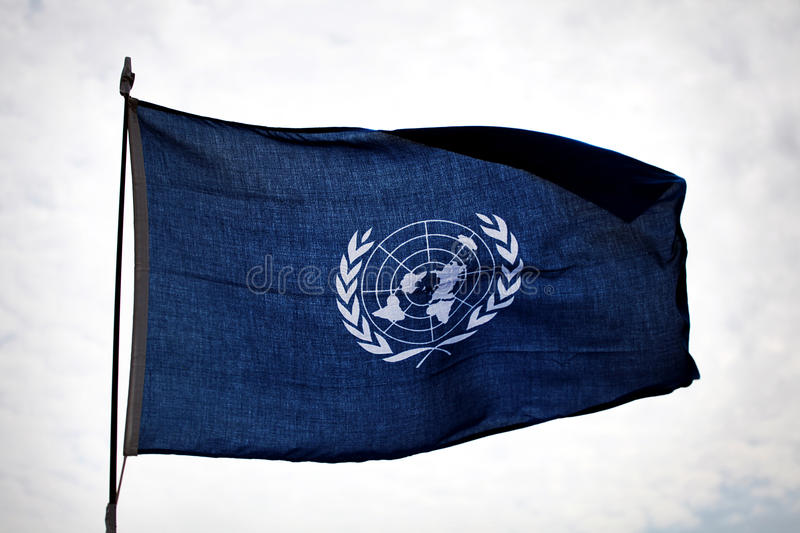 UN flag waving on patrol royalty free stock photography