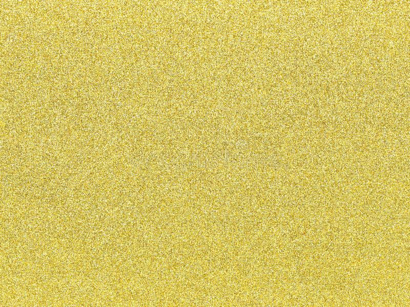 Un fond de scintillement d'or comme texture abstraite photographie stock