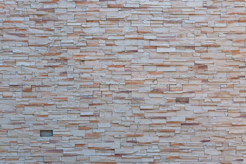 Un fondo astratto di struttura variopinta della parete di pietra fotografie stock