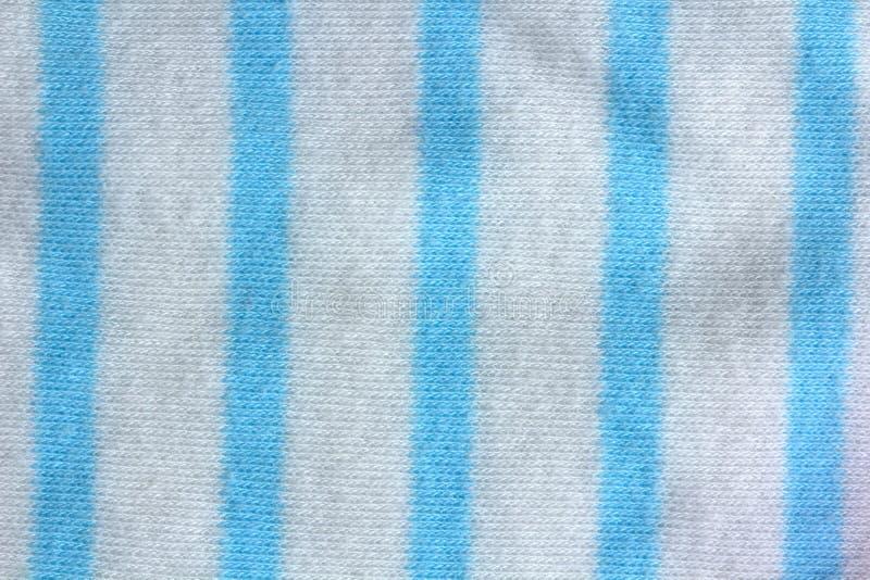 Un fondo blu scuro del tessuto del percalle che è senza cuciture fotografie stock libere da diritti
