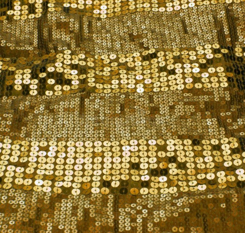 Lentejuela del oro foto de archivo