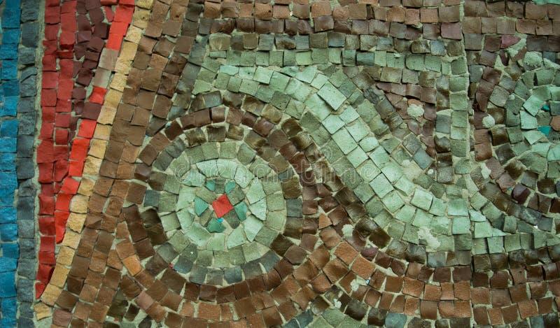 Un fondo decorativo coloreado de la piedra de pavimentación foto de archivo libre de regalías