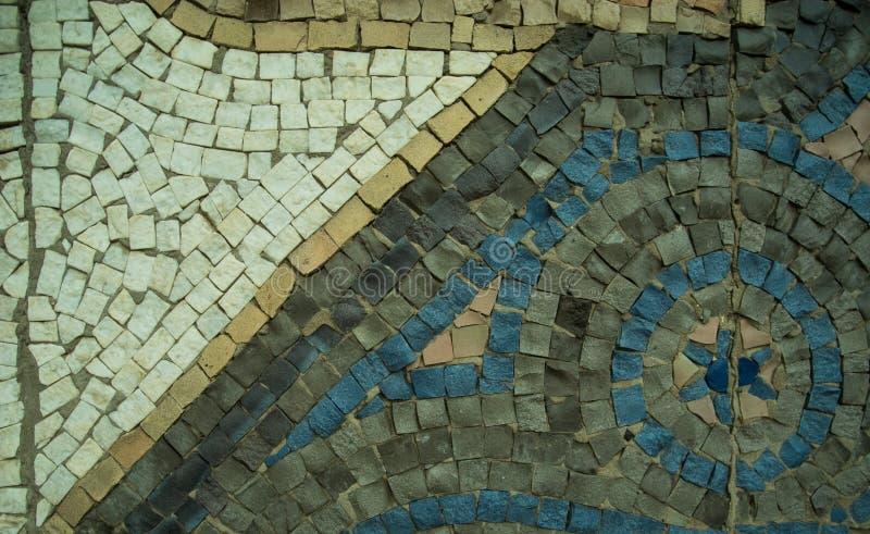 Un fondo decorativo coloreado de la piedra de pavimentación con la visión diagonal fotografía de archivo