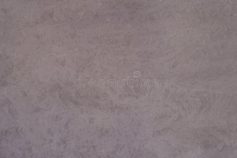 Un fondo rosso terroso strutturato della superficie della parete dello stucco fotografie stock
