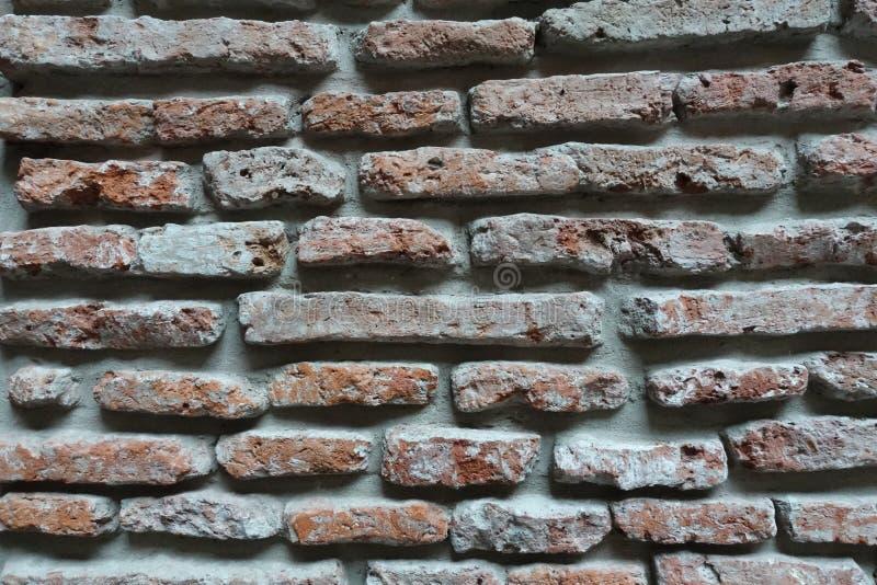 Un fondo rustico del muro di mattoni immagine stock