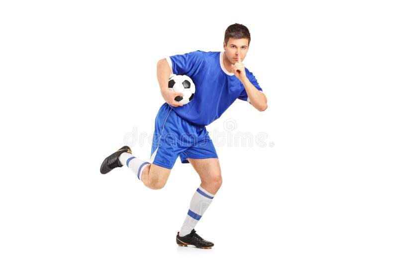 Un Footballeur Exécutant Et Faisant Des Gestes Le Silence Photographie stock libre de droits