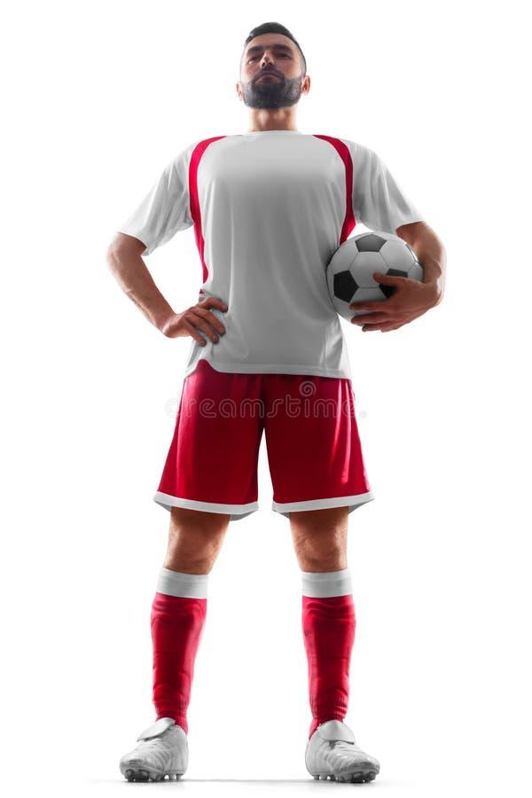 Un footballeur statique professionnel avec une boule dans des ses mains 56mm empilées vers le haut dans une pile organisée Le foo image libre de droits