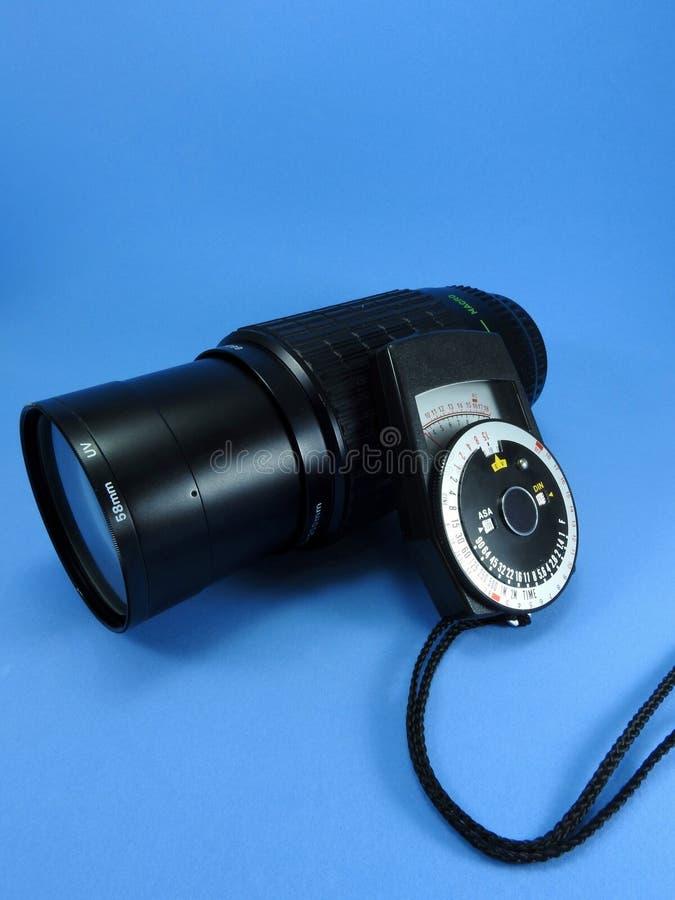 Un fotometro d'annata e uno zoom per la macchina fotografica di SLR fotografia stock libera da diritti