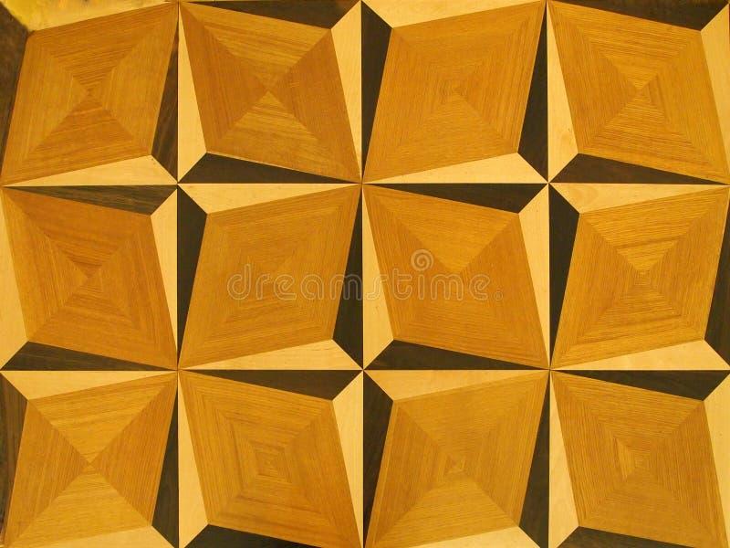 Un fragmento del suelo del mosaico, el fondo de madera texturizó el modelo en colores marrones claros fotografía de archivo libre de regalías