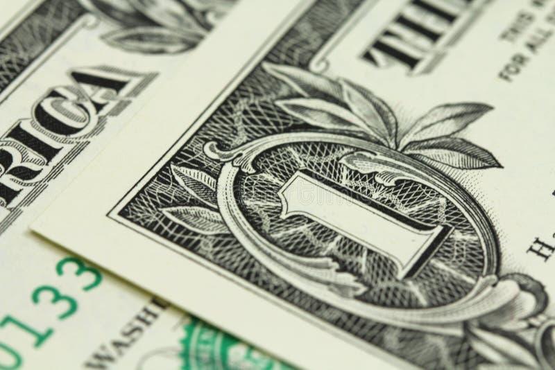 Un frammento di un fondo delle banconote in dollari immagine stock