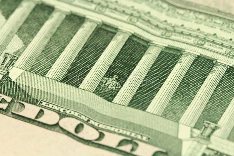 Un frammento di una denominazione di dieci dollari immagine stock