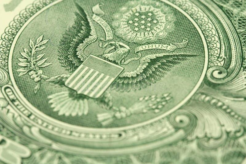 Un frammento di una denominazione di un dollaro americano con l'aquila fotografia stock