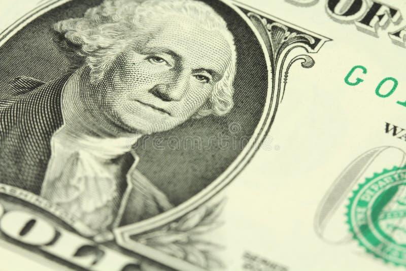 Un frammento di una denominazione di un dollaro americano un ritratto di George Washington fotografia stock