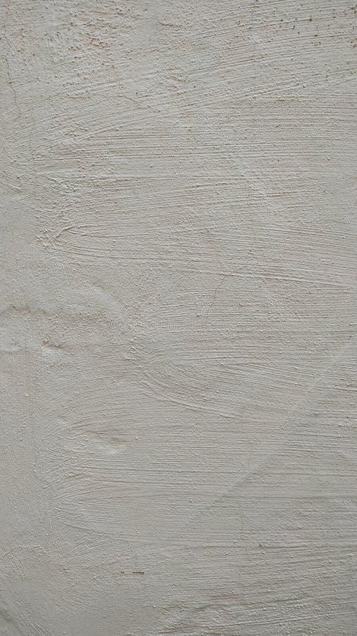 Un frammento di una parete coperta di stucco e dipinta in grigio Primo piano immagini stock
