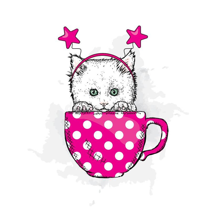 Un gatito lindo en una taza con un borde festivo en su cabeza Vector el ejemplo para una postal o un cartel ilustración del vector