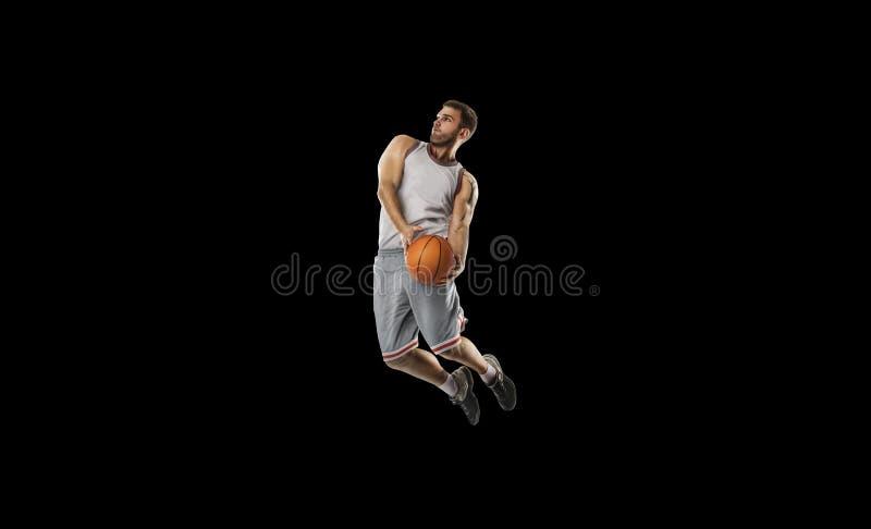 Un giocatore di pallacanestro salta l'isolamento immagini stock libere da diritti