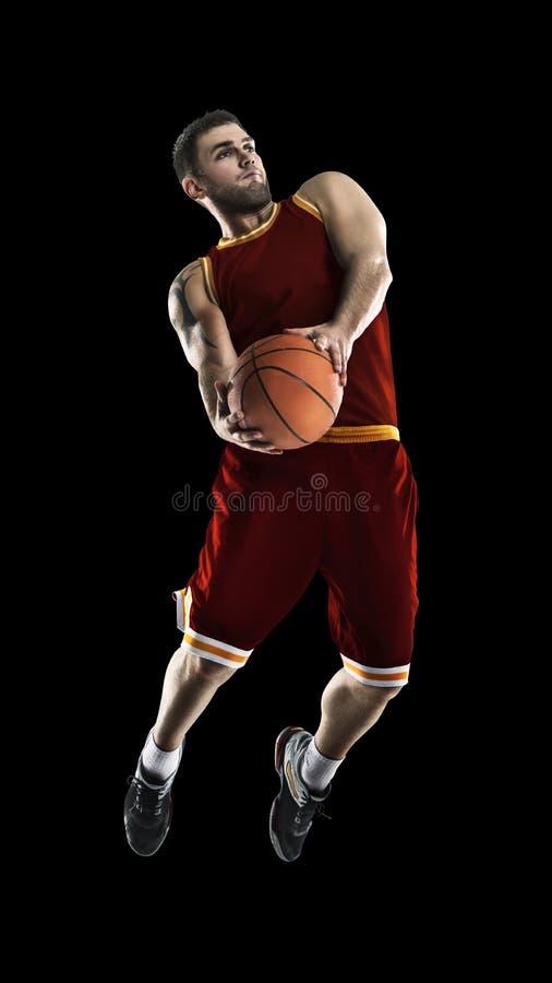Un giocatore di pallacanestro salta l'isolamento fotografia stock