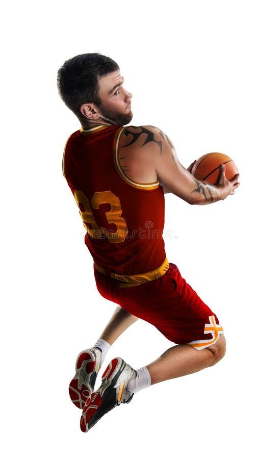 Un giocatore di pallacanestro salta l'isolamento fotografia stock libera da diritti