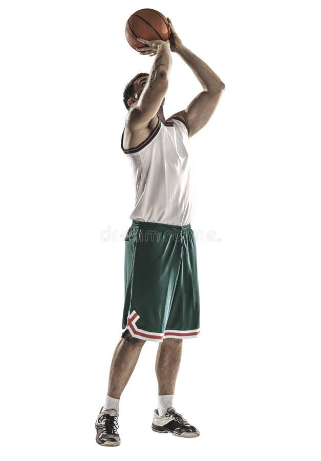 Un giocatore di pallacanestro salta l'isolamento immagini stock