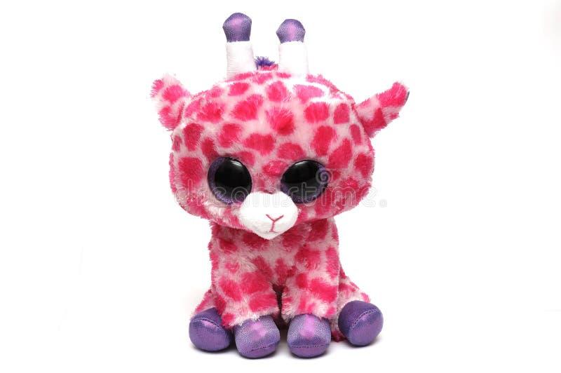 Un giocattolo molle della giraffa sveglia con i punti rosa fotografia stock