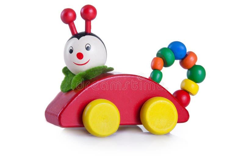 Un giocattolo multicolore del trattore a cingoli fotografia stock