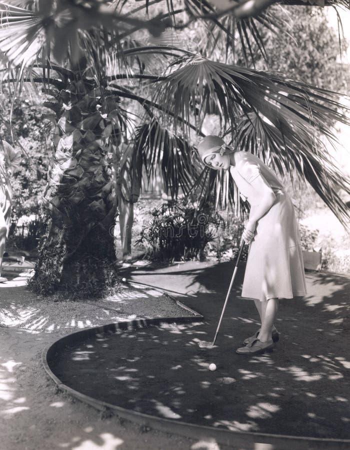 Un gioco di golf miniatura fotografie stock