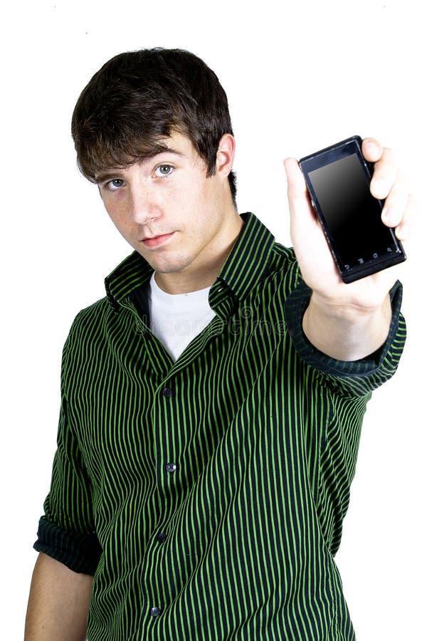 Un giovane che tiene un telefono fotografie stock