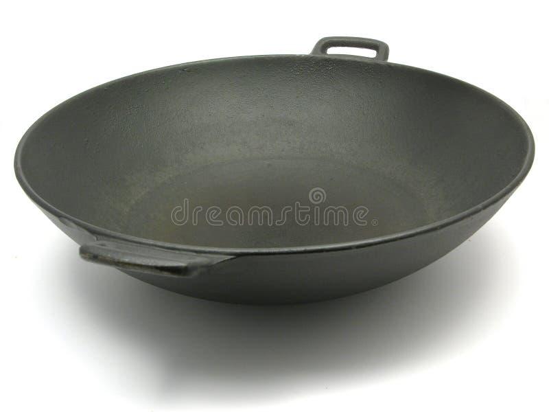 Un grande wok nero fotografia stock libera da diritti
