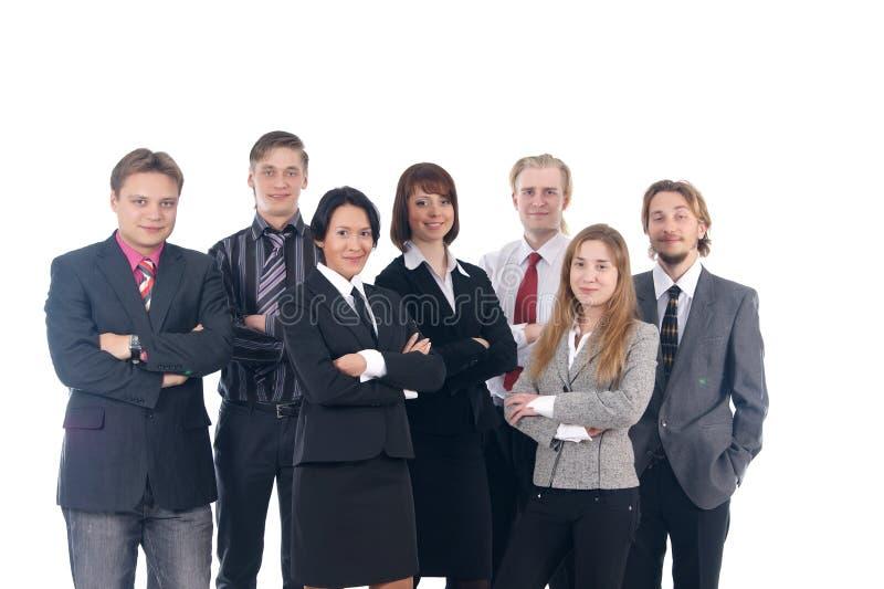 Un grupo de siete hombres de negocios jovenes foto de archivo