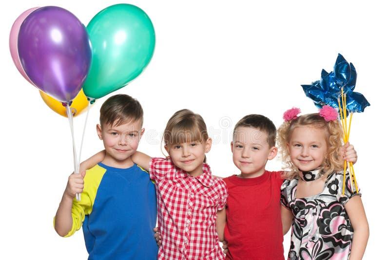 I bambini celebrano un compleanno fotografia stock