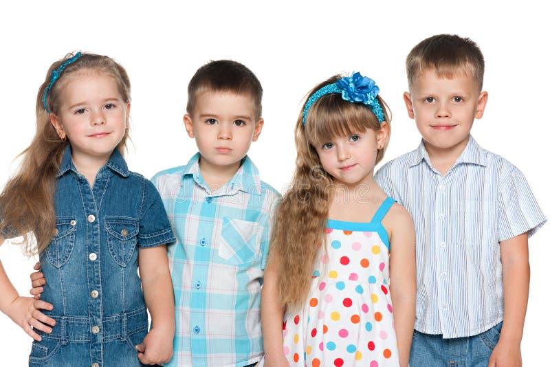 Un gruppo di quattro bambini di modo immagine stock