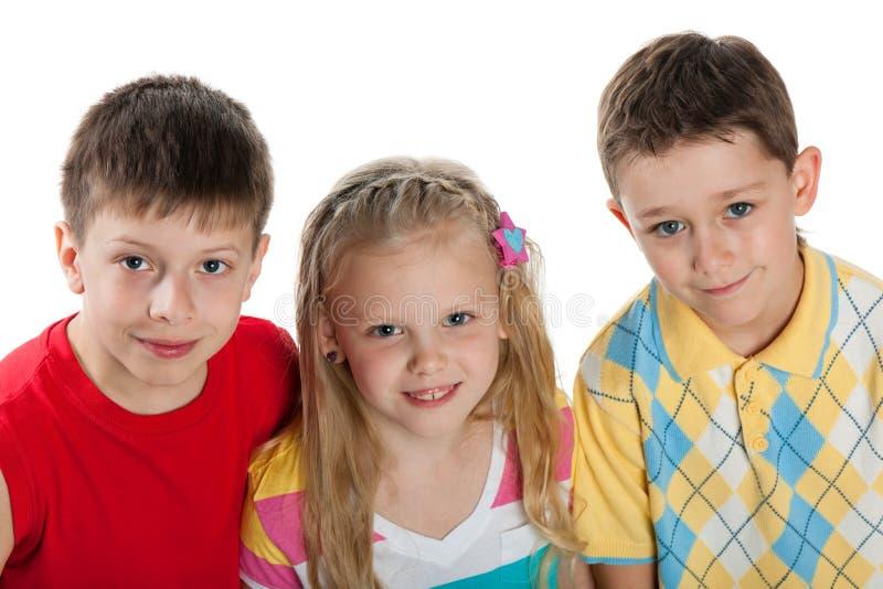 Un gruppo di tre bambini immagine stock libera da diritti