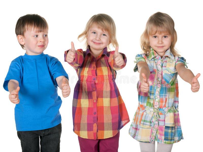 Un gruppo di tre bambini immagine stock