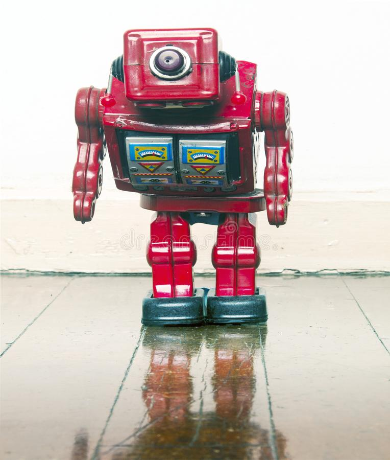 Un happy red robot on wooden floor royalty free stock image
