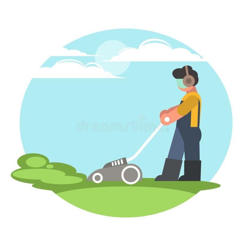 Un hombre corta la hierba con un cortacésped foto de archivo