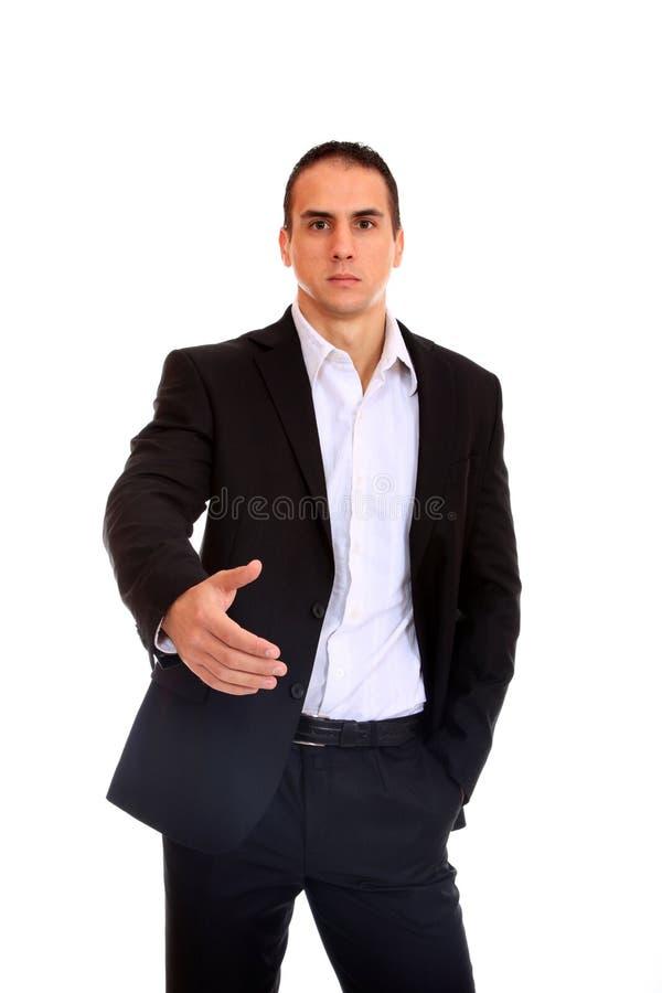 Un hombre de negocios con una mano abierta fotos de archivo