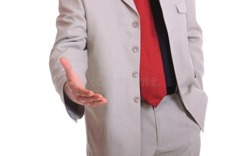 Un hombre de negocios con una mano abierta imagen de archivo
