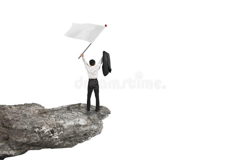 Un hombre de negocios que anima en bandera que agita del acantilado con el backgroun blanco fotografía de archivo libre de regalías
