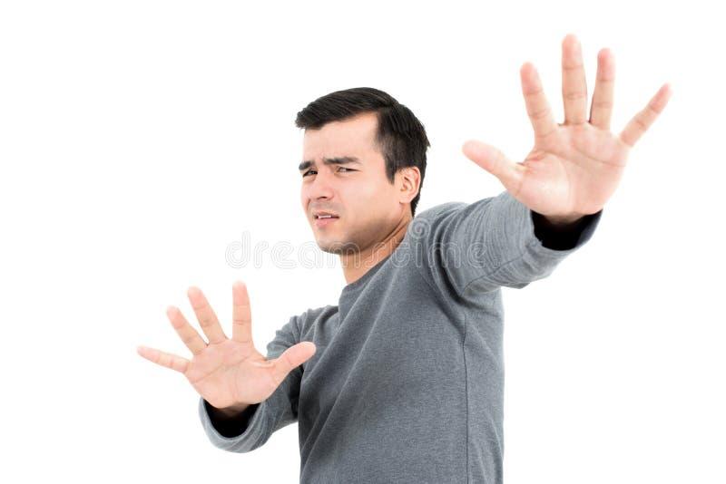 Un hombre que hace la parada o ningún gesto foto de archivo libre de regalías