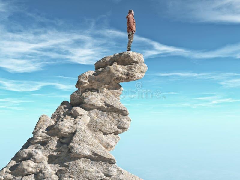 Un hombre que se coloca en un acantilado de piedra imagen de archivo libre de regalías