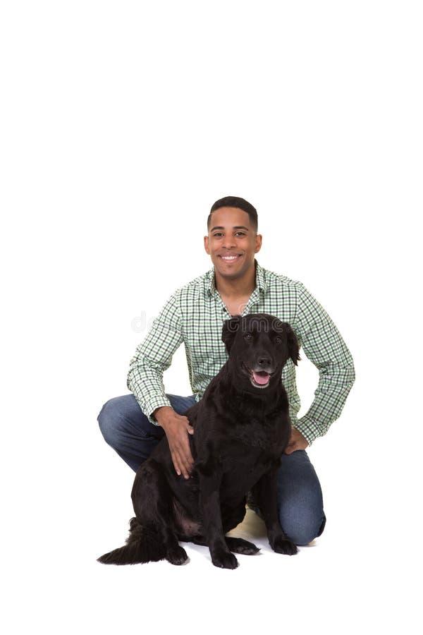 Un hombre y su perro imagen de archivo