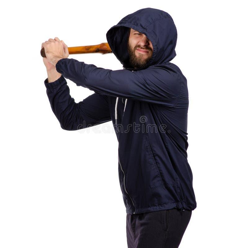 Un homme avec une batte photographie stock