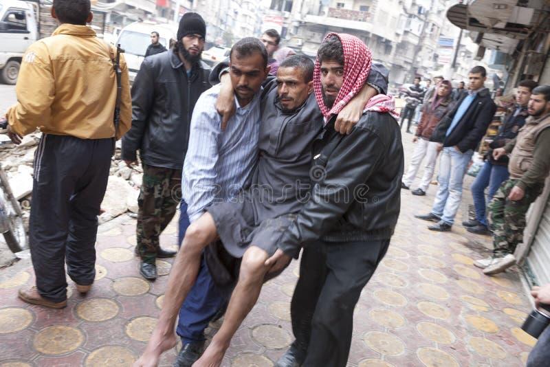 Un homme blessé, hôpital Alep. photos stock