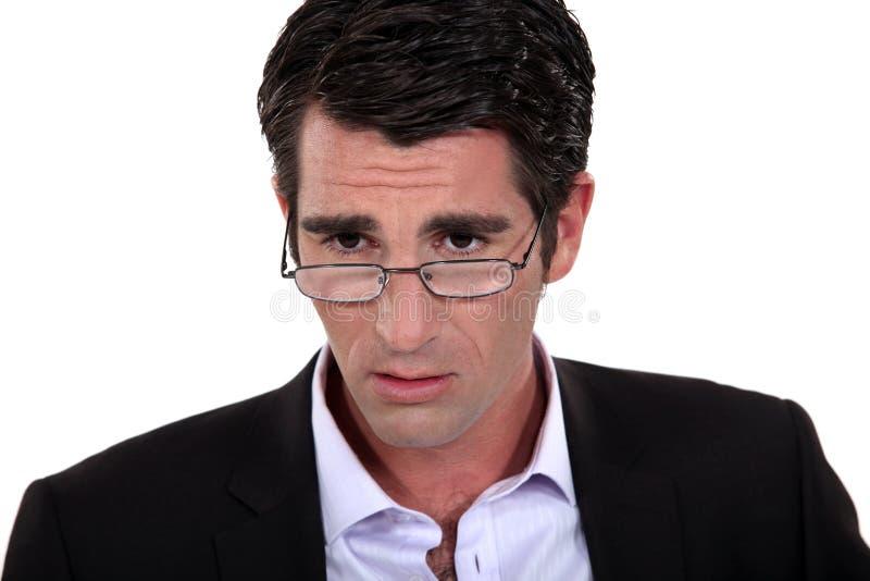 Un homme d'affaires soucieux. photographie stock libre de droits